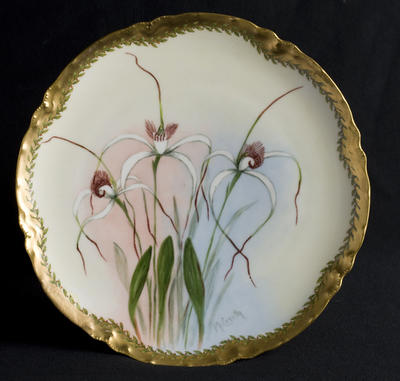 Plate with Spider orchid decoration; c 1920; 2012/0034