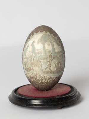 Carved Emu egg and stand